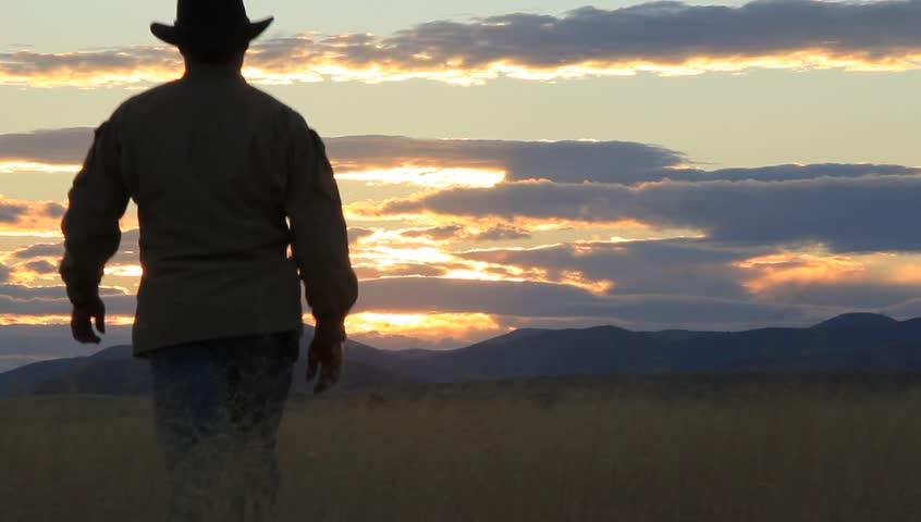 Rancher Surveys His Ranch at Sunset
