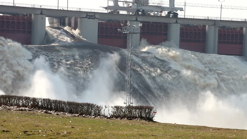 Spring flood water flowing on hydroelectric power station dam - HD stock video clip