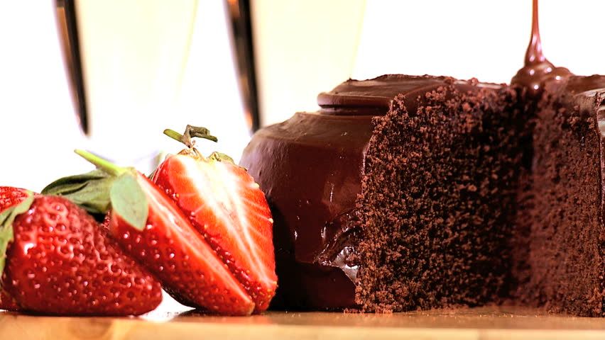 Indulgent sticky chocolate cake served with fresh strawberries & sparkling white wine - HD stock footage clip