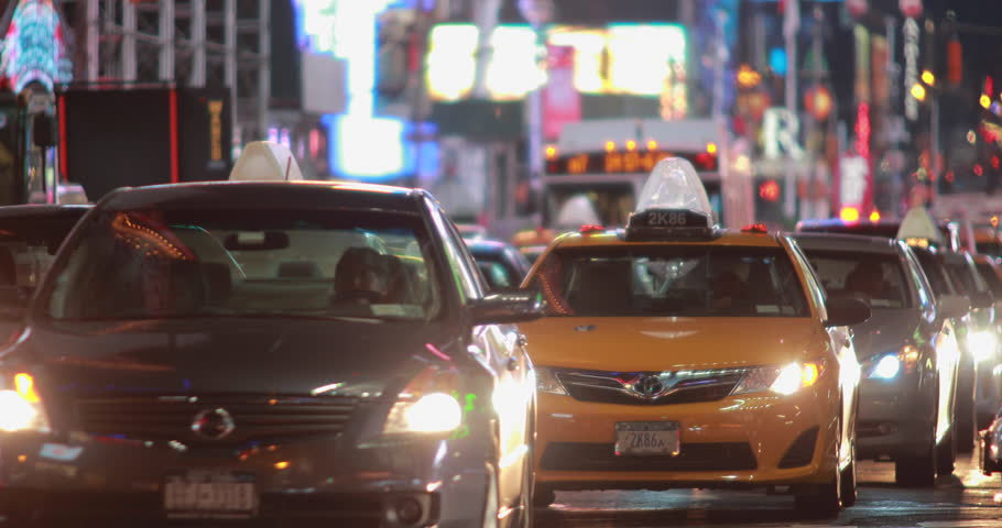 NEW YORK - CIRCA SEPTEMBER 2014: Cars driving at night in Times Square - 4K stock video clip