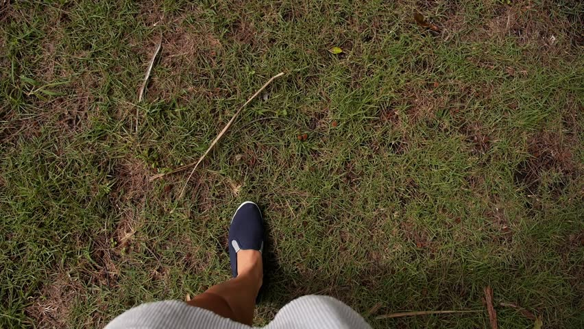 Female Legs in Street Slippers Walking on Green Grass. Slow Motion. HD, 1920x1080. | Shutterstock HD Video #7250452
