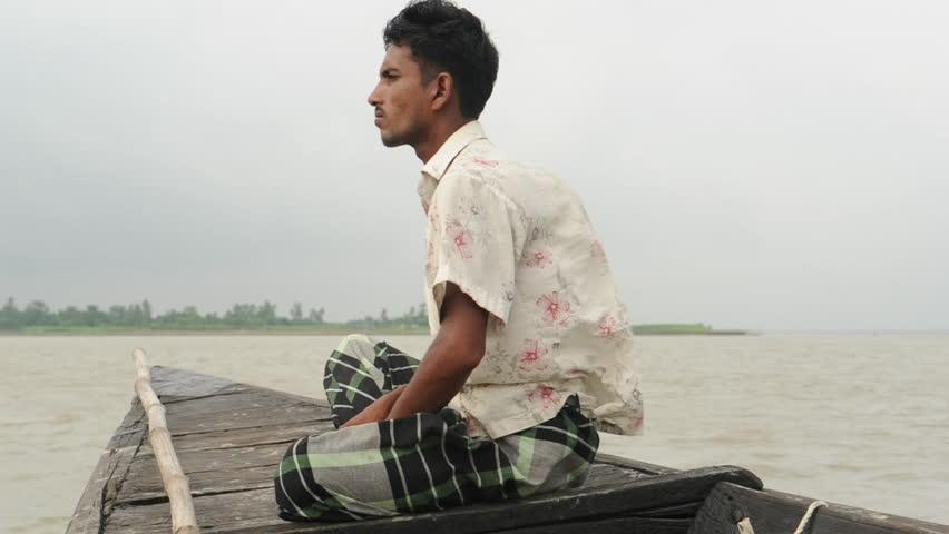 BANGLADESH - Aug 2010: Man leaving on boat