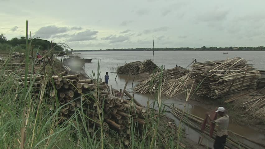 Cambodia - november 2013 : Bamboo bridge workers along the riverbank,