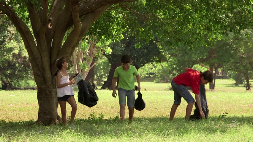 Ecology, children, young people, future and environment, portrait of latin american girl and boys cleaning a park from trash, rubbish, garbage. 14of18 - HD stock video clip