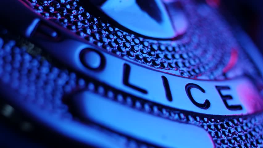 Stock Footage Police Badge and Gun Macro with Sound