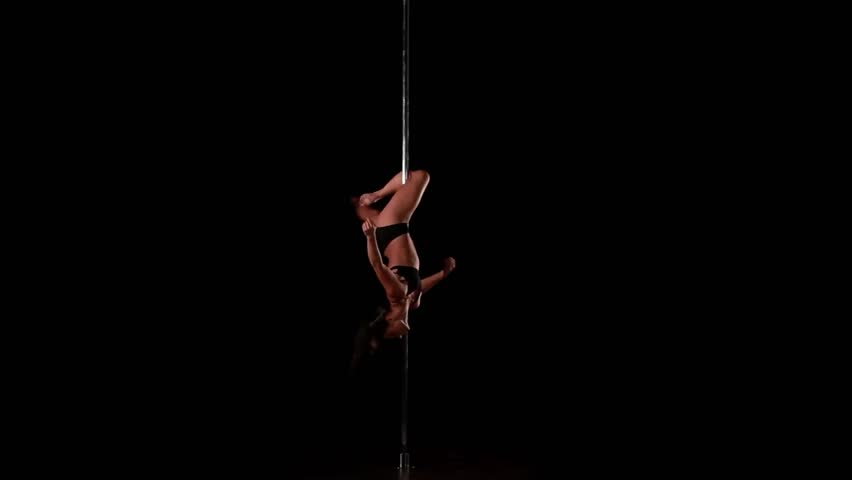 Young Sexy Woman Exercise Pole Dance Against A Green ...