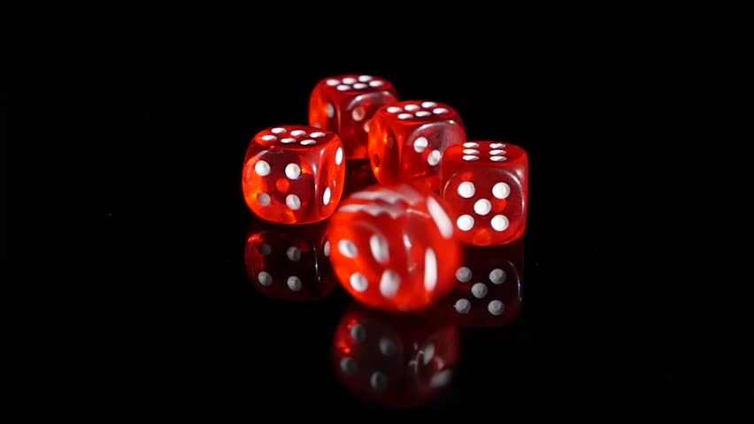 Throwing red dice on a black background in the casino 3 for Asino amiatino
