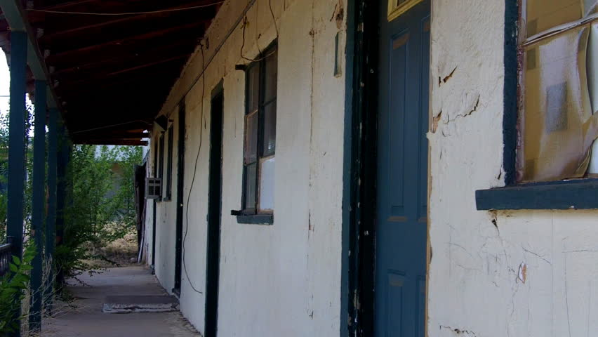 ASH FORK, AZ/USA: July 21, 2014-   A shot looking down a row of generic motel room doors at a run down, derelict, dilapidated motel on Historic Route 66 circa 2014 in Ash Fork.