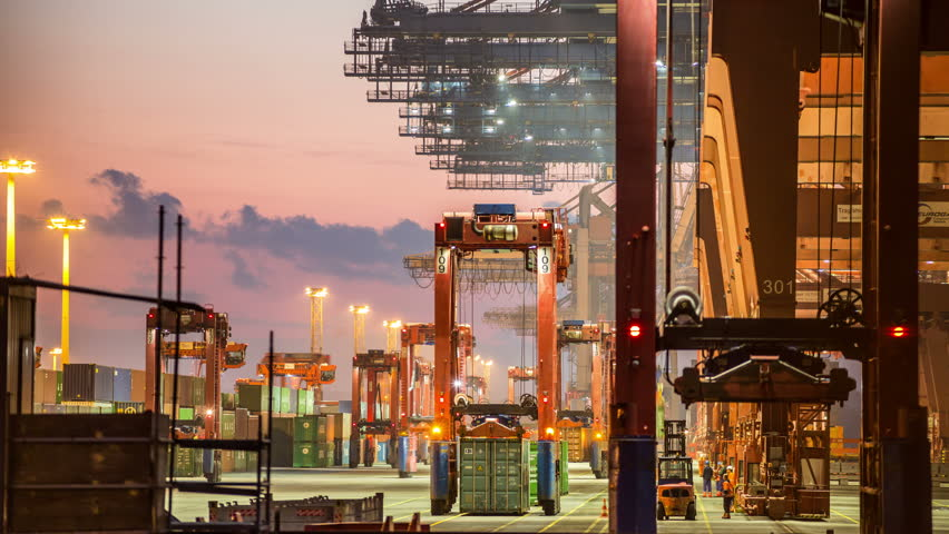 Crane working and loading container on ship in evening -  heavy industry - harbor timelapse  | Shutterstock HD Video #7339840