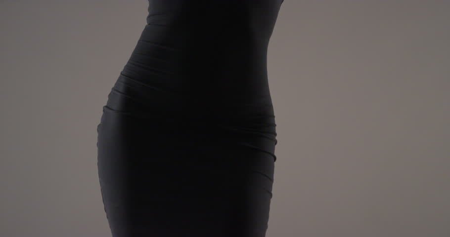 Close up mid section of woman in black dress dancing - 4K stock video clip