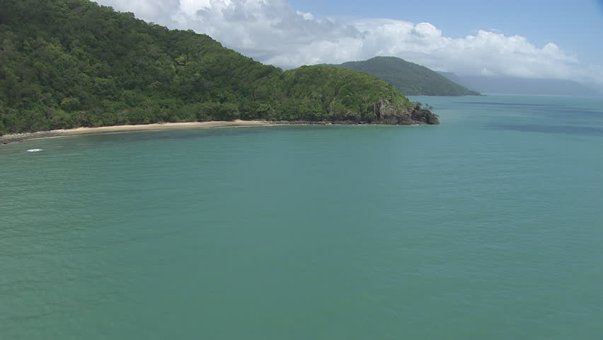 Aerial view of the ocean and a forested coast in Daintree National Park #7384849