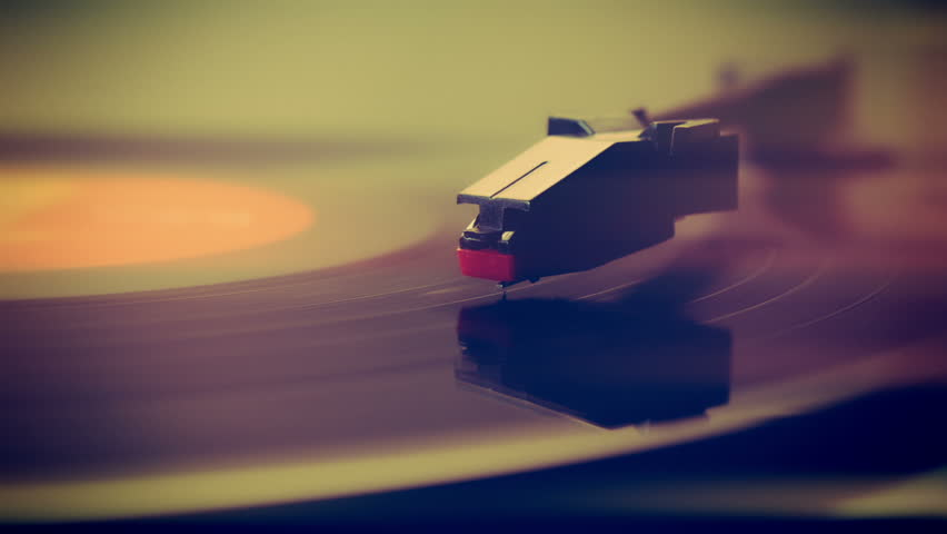 Record player turntable HD stock footage.A record player turntable with it's stylus running along a vinyl record