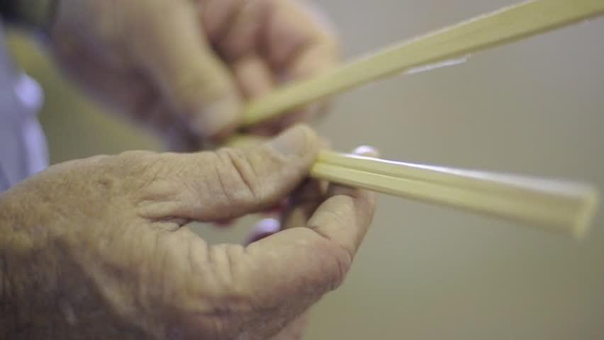 A close up elderly hands holding chopsticks. 1080p HD. | Shutterstock HD Video #7416952