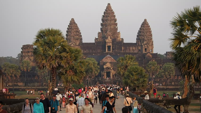 Angkor, Siem Reap, Cambodia - January 4: Tourists at the temple of Angkor Wat, the world's largest religious building, in Siem Reap, Cambodia. - HD stock footage clip