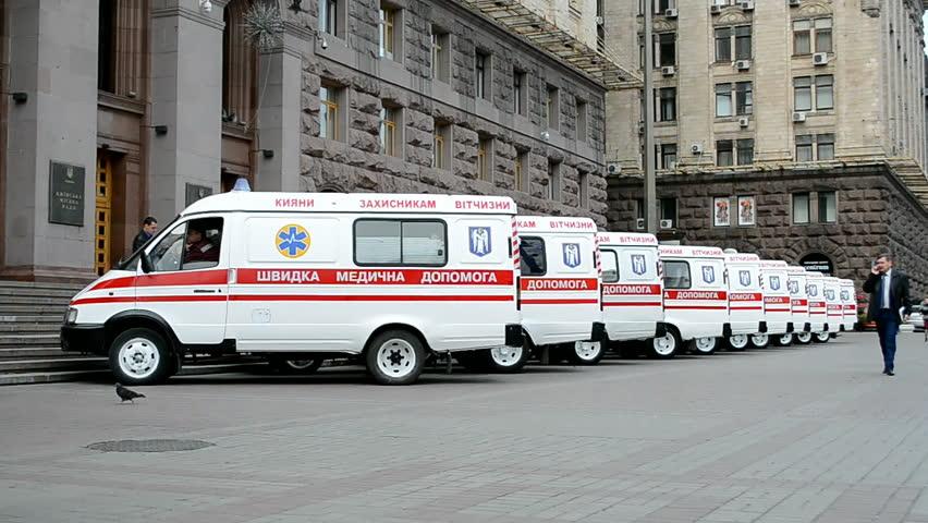 KIEV - SEP 26: Ambulance cars near Kyiv City State Administration before transportation to military zone in Eastern Ukraine on September 26, 2014 in Kiev, Ukraine.