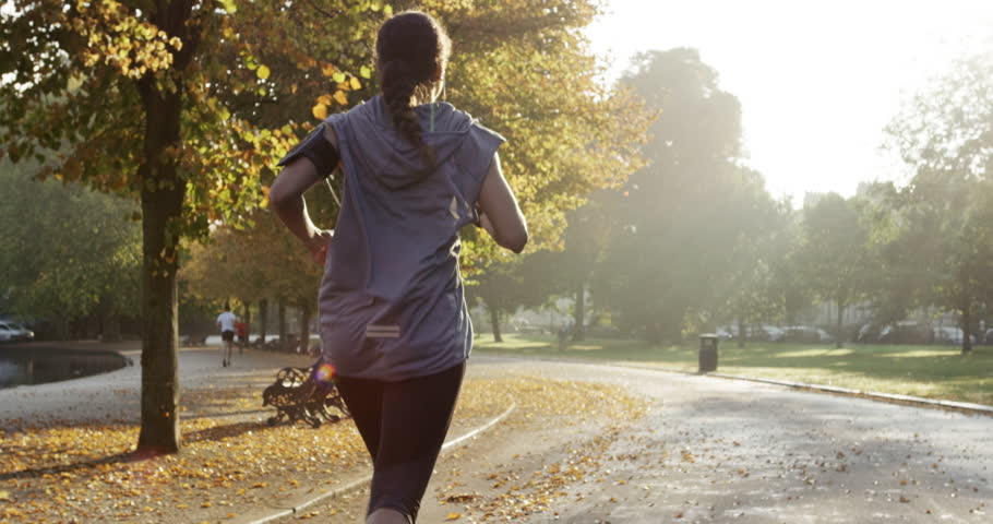 Runner woman running in park exercising outdoors fitness tracker wearable technology | Shutterstock HD Video #7457047