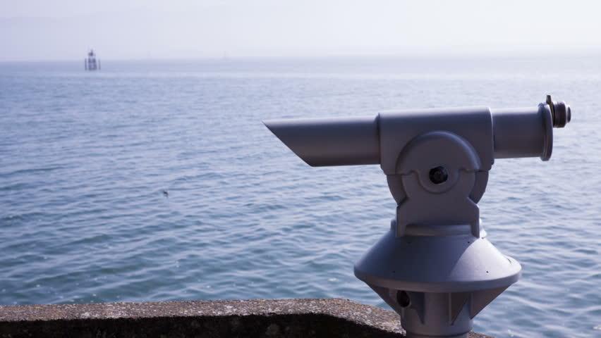 coin-operated binoculars at a lake #7471465