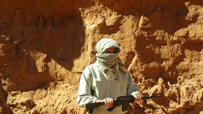 A terrorist in the desert - HD stock footage clip