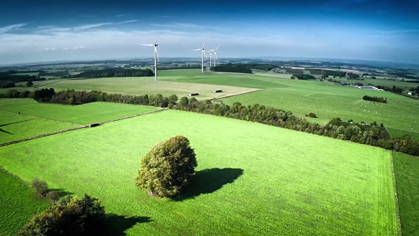 Aerial view of summer countryside with agricultural fields and wind turbines. Full HD, 1080p