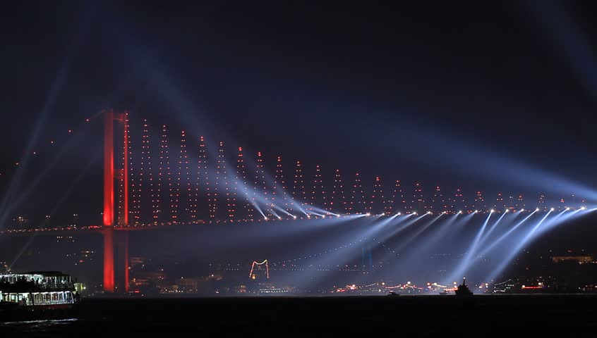 ISTANBUL - OCT 29 2013: Running lights on Bosporus Bridge on October, 29 festival in Istanbul. The country's largest October 29th fireworks display even has pyrotechnics shooting off the Bosphorus.