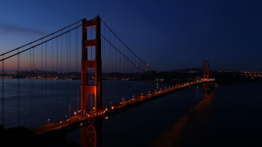 Timelapse of San Francisco's famous Golden Gate Bridge at sunrise. - HD stock footage clip