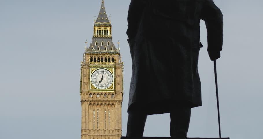 London. June 2014.Winston Churchill statue facing Big Ben.