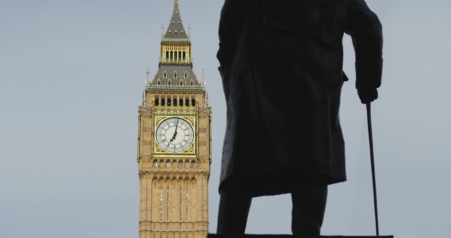 London. June 2014.Winston Churchill statue facing Big Ben.