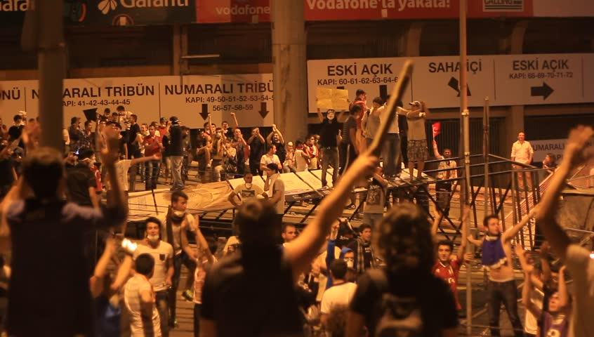 ISTANBUL, TURKEY - JUNE 1, 2013: Violence sparked by plans to build on the Gezi Park have broadened into nationwide anti government unrest. People keep protest at night,  Besiktas Dolmabahce Stadium