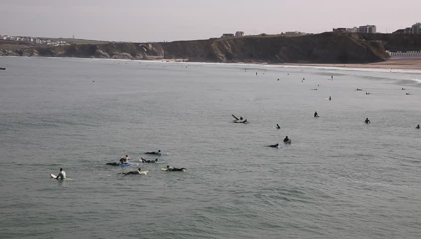Surfing on Newquay Towan beach North Cornwall England UK PAN - HD stock video clip