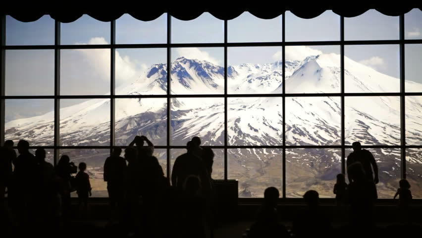 Silhouette of tourists viewing Mt. St. Helens from inside Johnston Ridge Observatory. - HD stock video clip