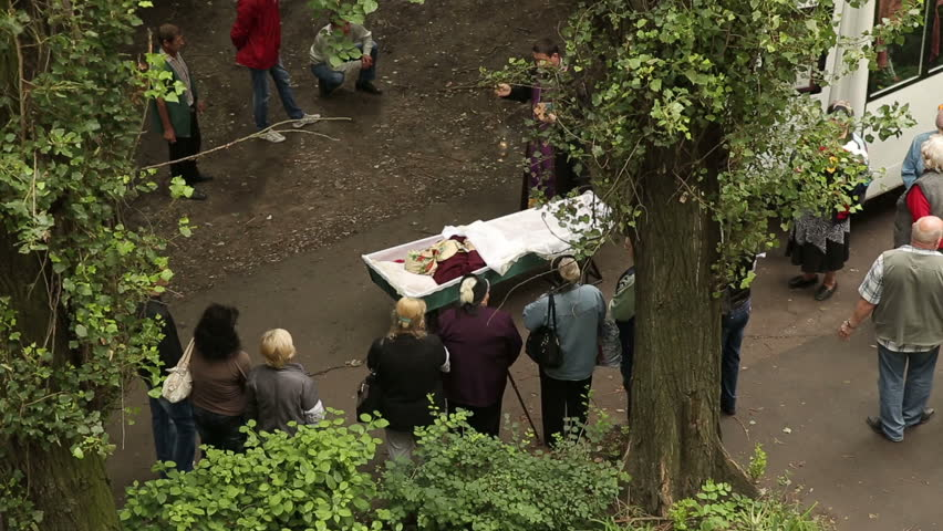 DONETSK, UKRAINE- 10 July 2014:  the priest says a prayer over the dead