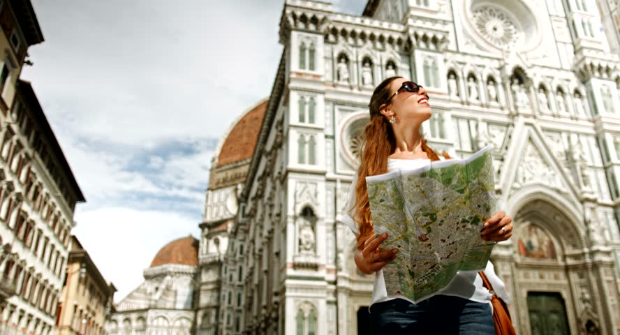 Young Woman Looking Map directions Vacation in Europe
