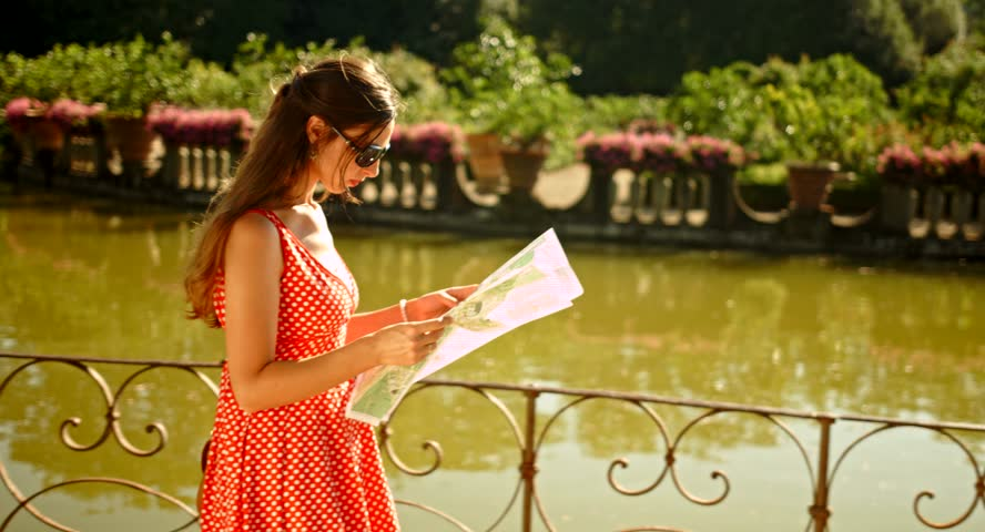 Attractive Woman Looking for Directions Holiday Vacation Europe