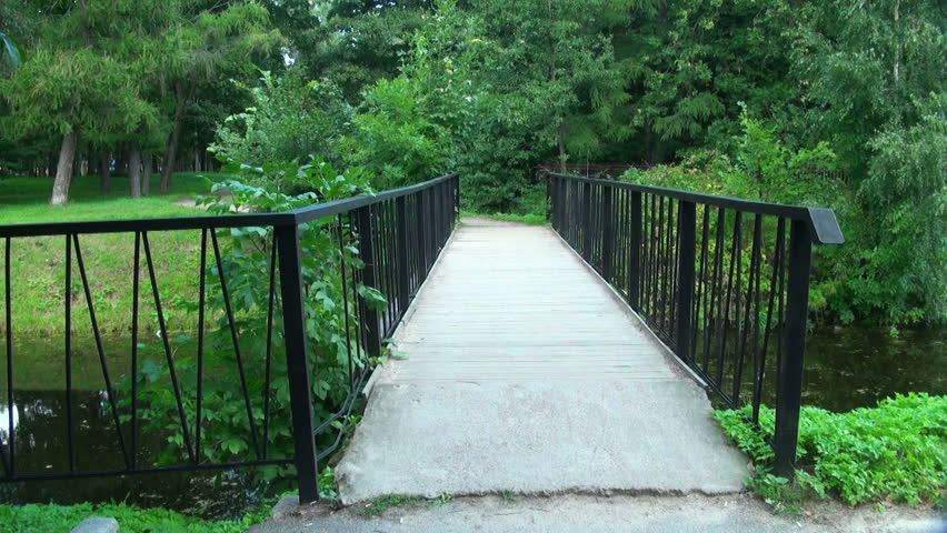 Bridge over the river in the Park - HD stock footage clip