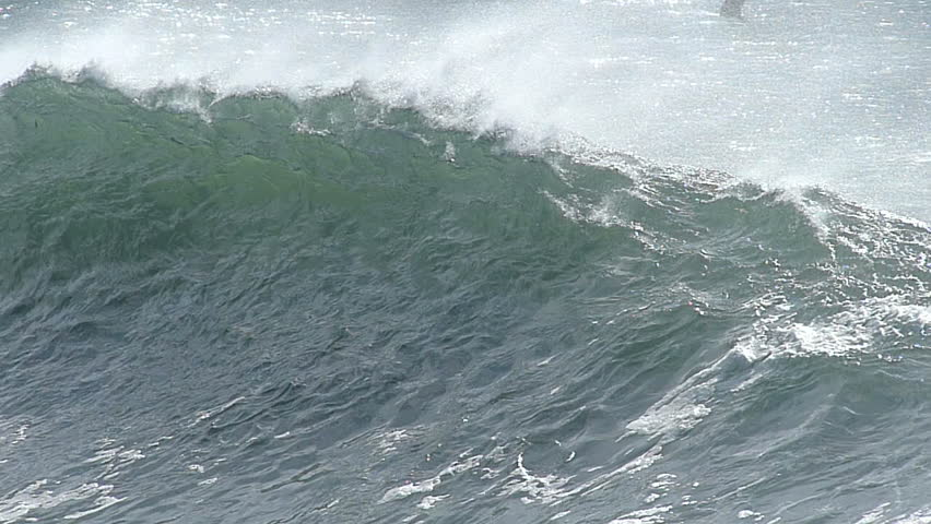A large ocean wave breaking in slow motion along the central coast of California, USA.