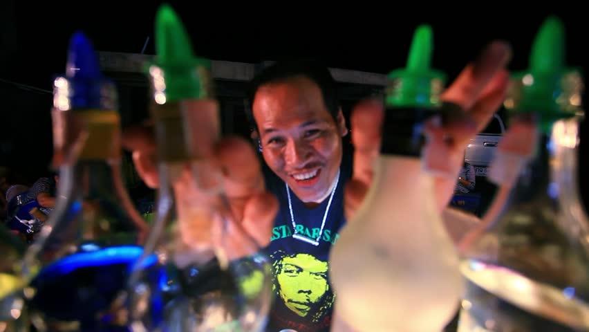 Thailand Koh Samui, 18 july 2014 Funny thai barman making impressive move and alcogolic cocktail. HD. 1920x1080