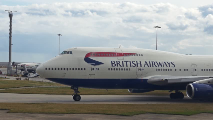 LONDON, GREAT BRITAIN - August 12, 2014: British Airways aircrafts in the the airport of Heathrow