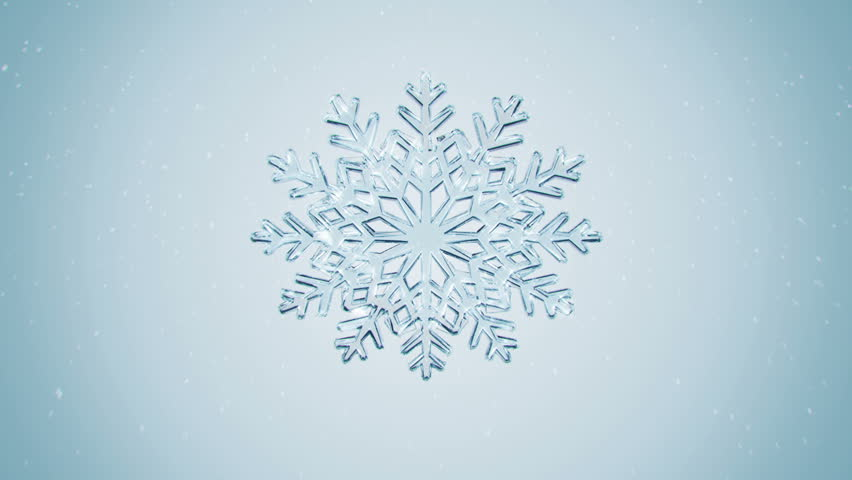 Big Christmas snowflake with snow on blue background. - HD stock video clip