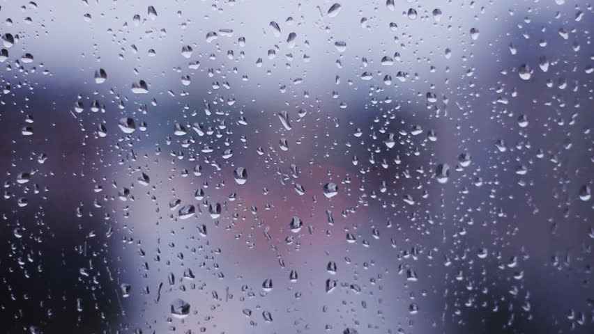 Rain drops on window out of focus traffic in the for Windows for cold climates