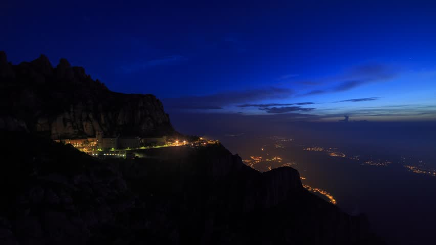 Monastery at Monserrat, Catalonia, Spain, night to day transition with clouds. Timelapse footage, 20 second, normal speed version.