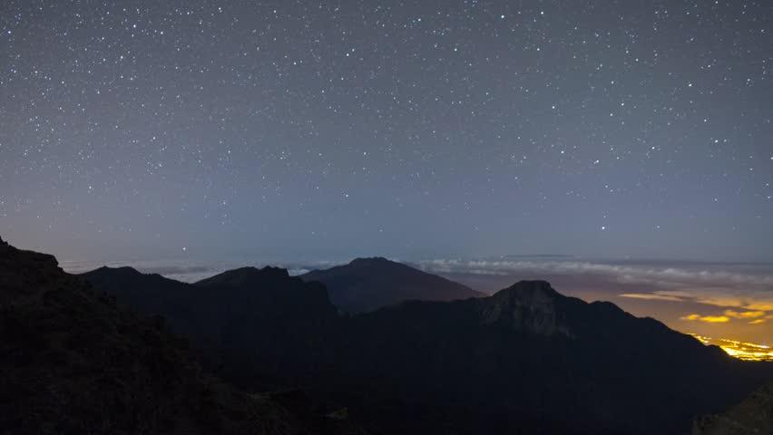 Stars, Clouds, Moon shadow timelapse on La Palma, Canary Islands
