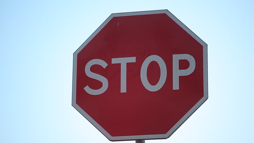 Stop road sign on the sky background | Shutterstock HD Video #7784611