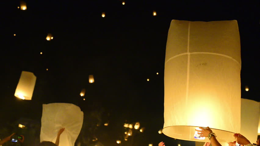 Launching hundreds of rice paper hot air balloons, or sky lanterns, during the Yii Peng/Loi Krathong festival in Chiang Mai, Thailand.