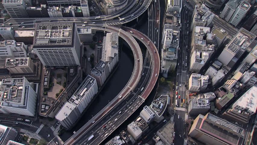Aerial overhead Metropolis view Hakozaki Interchange Tokyo city elevated vehicle Expressway large Urban area Japan