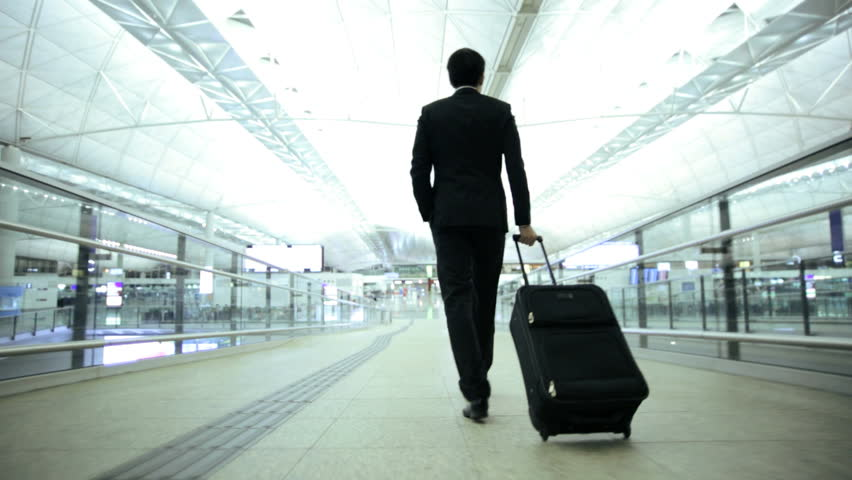 Smart Asian Chinese male financial consultant city airport travel tourism conference baggage departure destination corporate business | Shutterstock HD Video #7810063