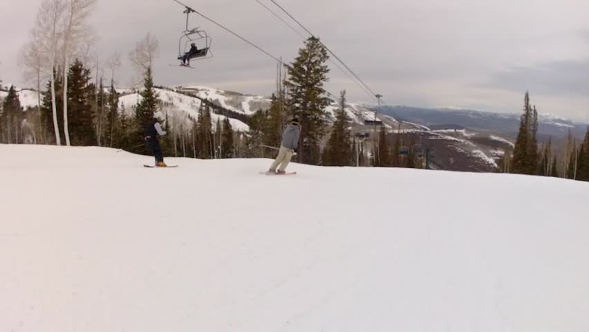 A man trick skiing on a mountain resort in Park City Utah - HD stock footage clip