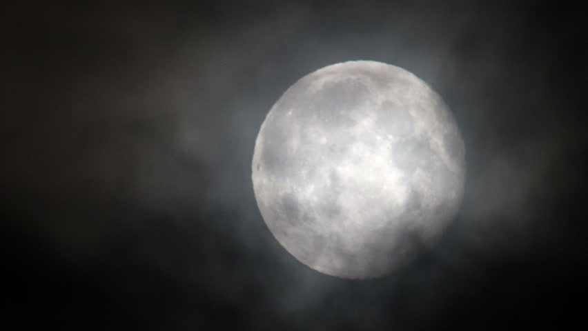 Full moon rising through dark clouds super close up | Shutterstock HD Video #7825003