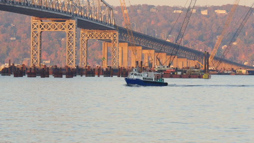 TARRYTOWN, NY - NOVEMBER 11:   A shuttle boat carrying construction workers for the new Tappan Zee Bridge heads for Westchester County on November 11, 2014 in Tarrytown.