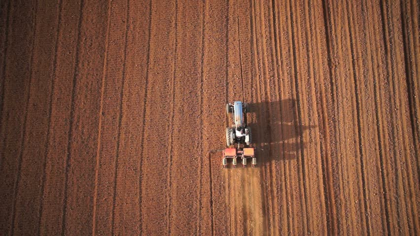 Aerial of tractor on harvest field (top view from height) #7898920