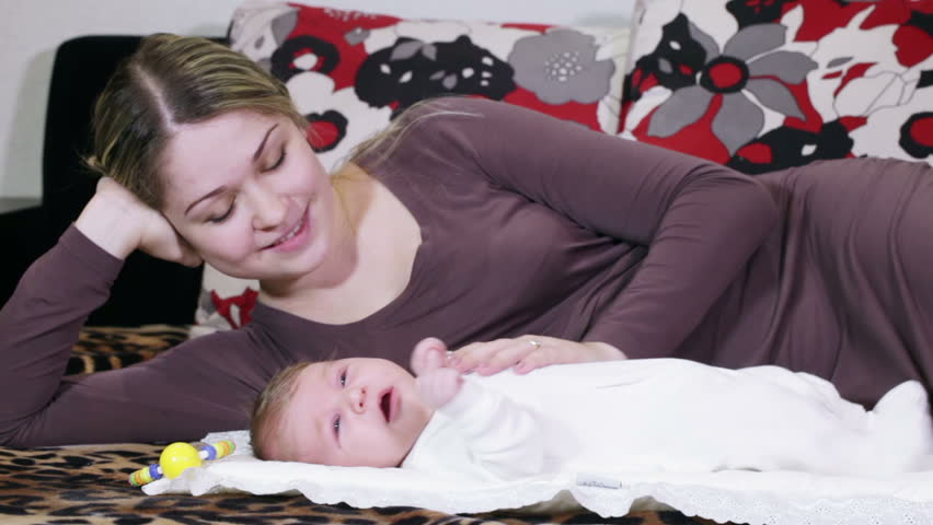 Young mother comforting her son and playing with him | Shutterstock HD Video #7902025